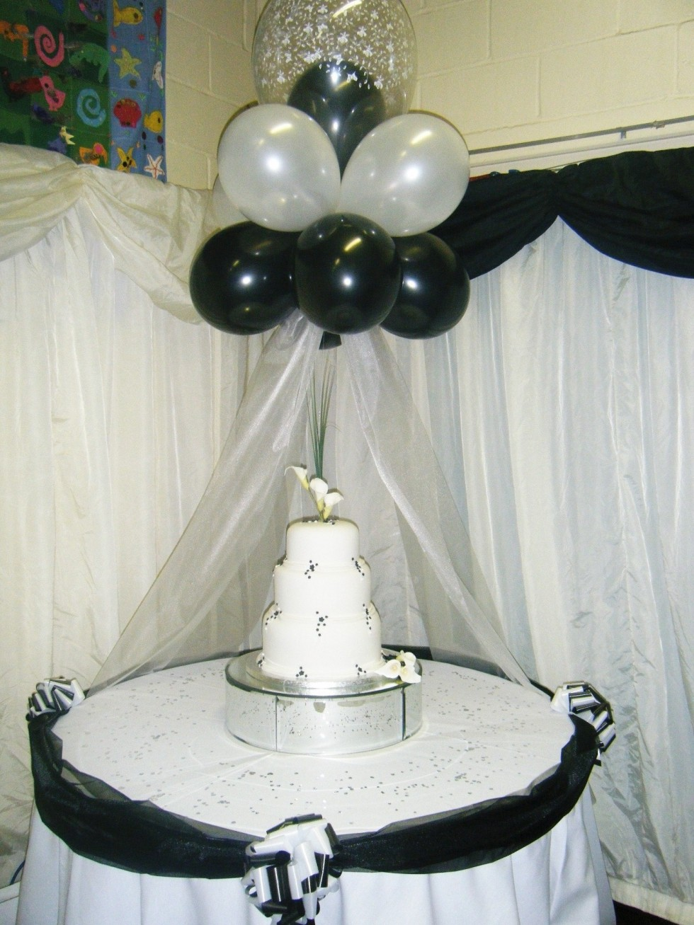 Balloons photogalleries rainbow weddings wedding and for Balloon cake decoration