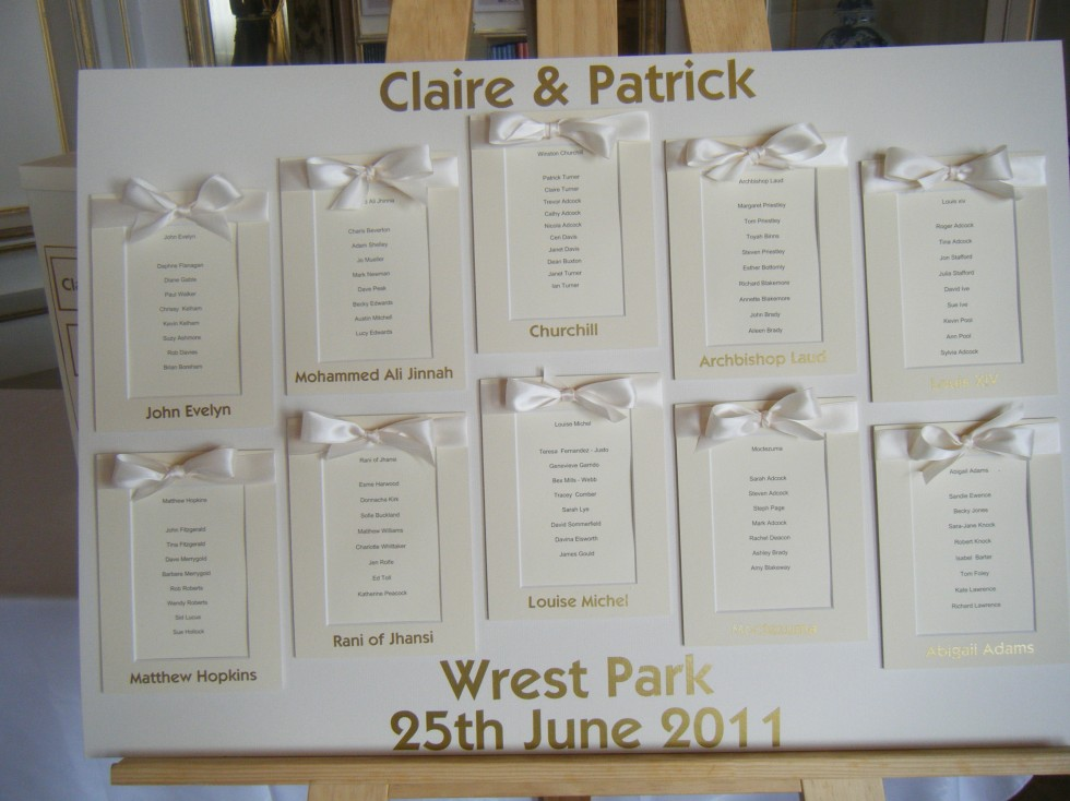 Ivory And Gold Table Plan With Satin Bows