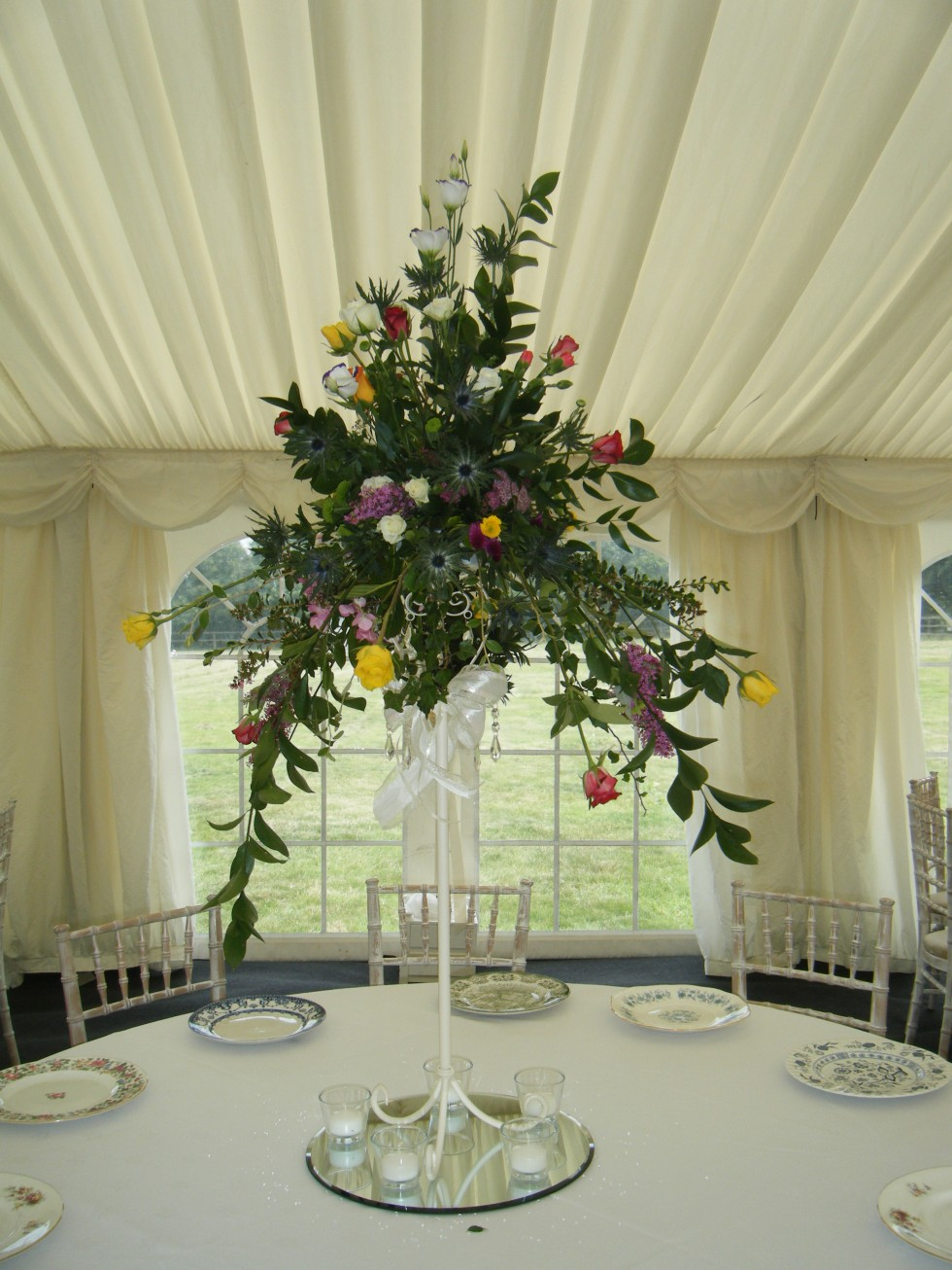 Hire photogalleries rainbow weddings wedding and events tall vintage mixed country flowers table centrepiece on a hired candle holder junglespirit Gallery
